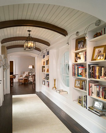 Built-in shelving enhances this hallway space