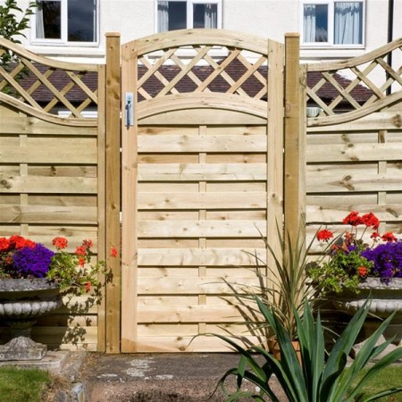 Wood garden gate with pretty trim