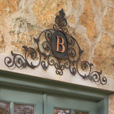 Outdoor monogrammed sign above the front door