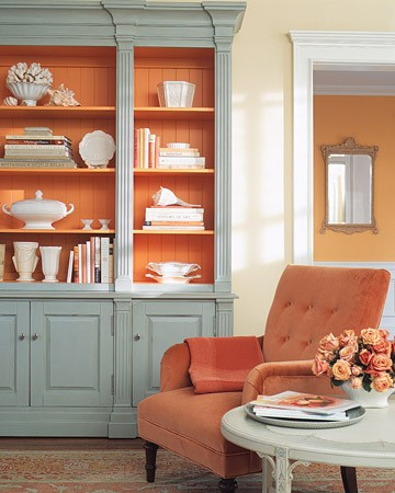 Coral painted interior on this aqua cabinet offers a pretty contrast for display
