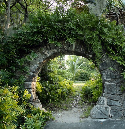 Stone surround makes an impressive garden entrance