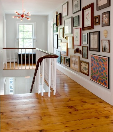 Artwork enhances this hallway and serves as a gallery