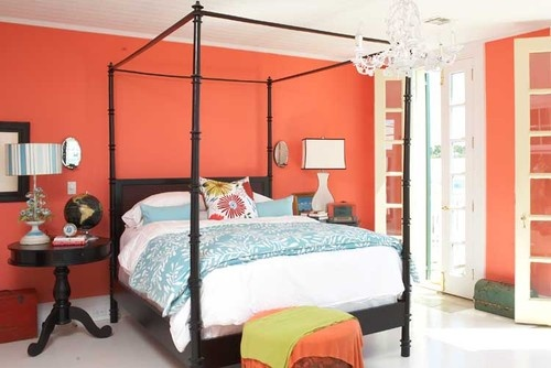 Dramatic coral is bright and fresh in this bedroom
