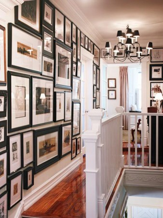 Framed photos highlight this hallway