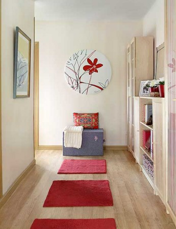 Bright rugs add color to the hallway