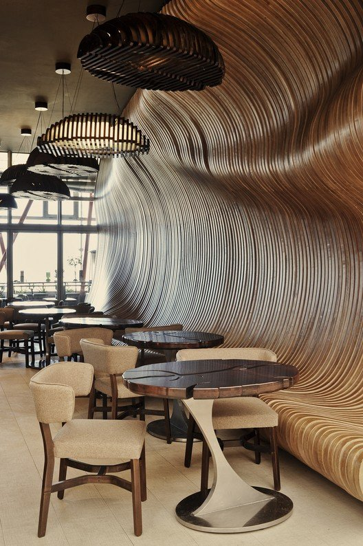 Coffee inspired fluidity animates the cafe  (www.archdaily.com)