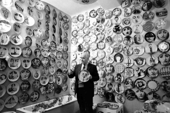 Piero Fornasetti pictured with some of his work