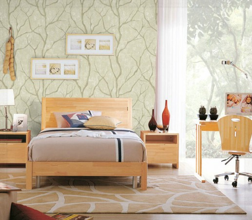 Branches wallpaper in a soft green wake up this nature-inspired bedroom