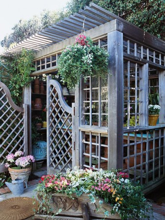 A decorative lattice enclosure makes for a charming backyard escape