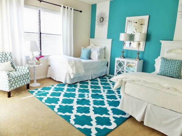 Placing twin beds on opposite sides of the room can open up the space for more individual space (bemyguestwithdenise)