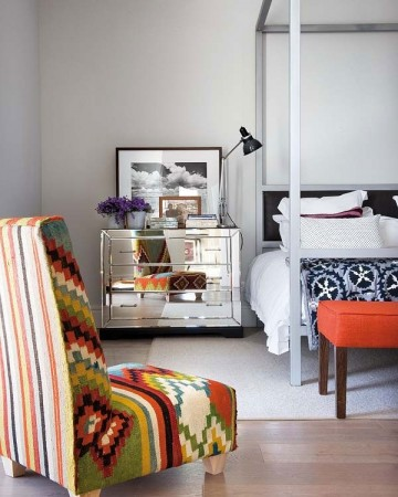 Colorful tribal prints bring life to this bedroom