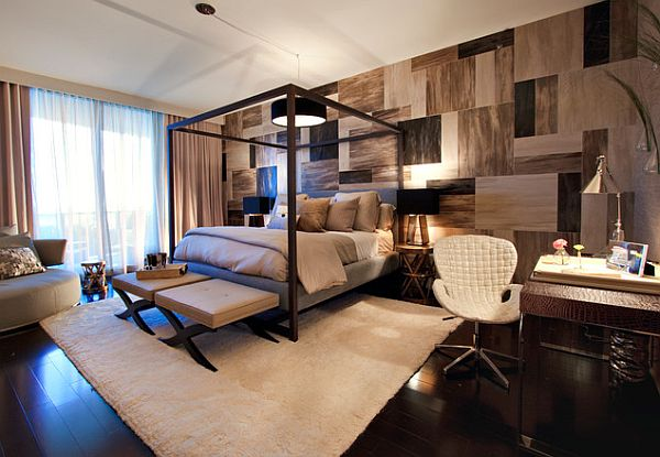 Tiles on the bedroom wall bring texture and interest to this bedroom