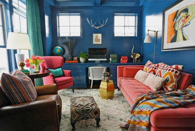 Bold glossy paint and vibrant hues of upholstery give this room an eclectic charm