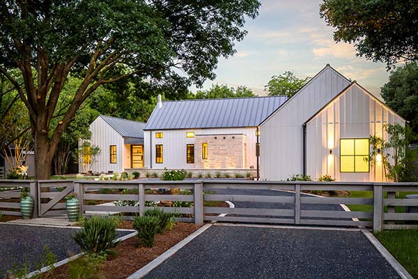 A modern farmhouse looks warm and inviting