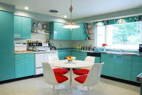 Red seat cushions contrast nicely with aqua cabinets