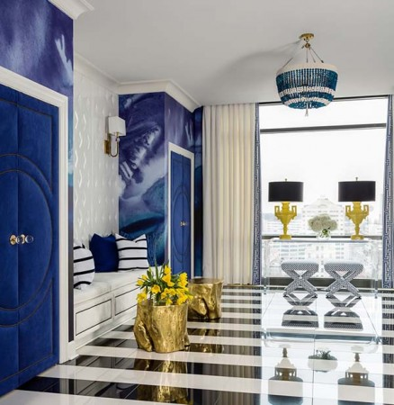 Bold blue and reflective surfaces highlight this space