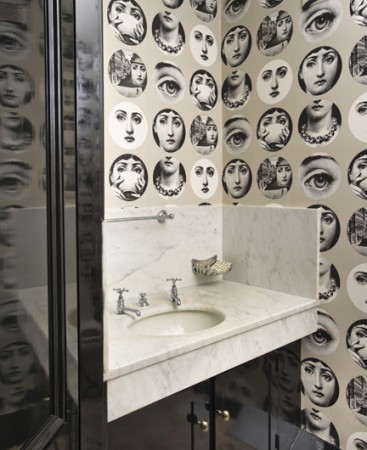 Fornasetti wallpaper in the powder room