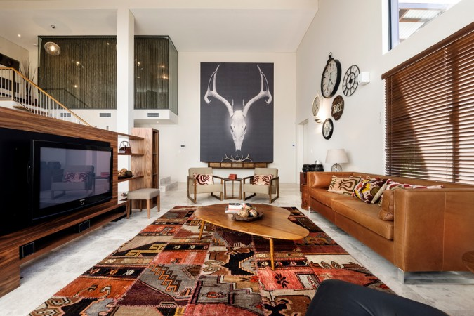 Tribal print rug sets the tone of this room