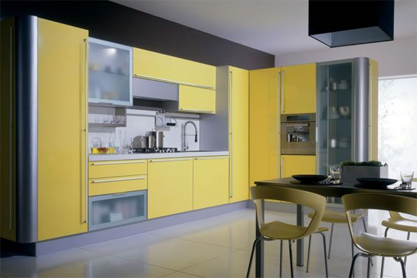 Fresh yellow cabinetry perks up this kitchen