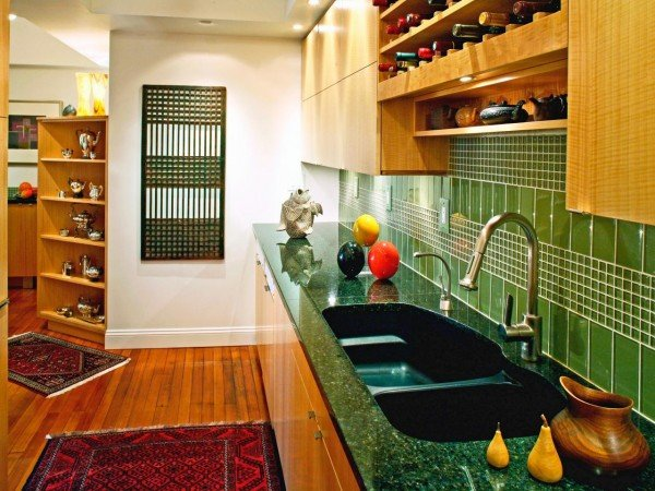 Green tiles highlight this kitchen