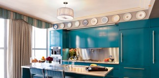Turquoise cabinets bring vibrant color to this contemporary kitchen