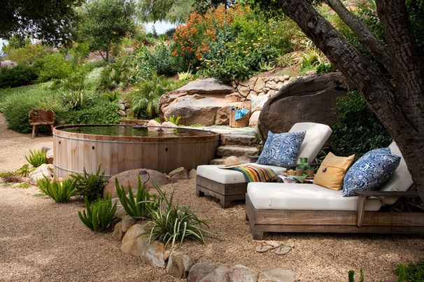 Comfy lounge chairs in a secluded backyard area are the perfect escape
