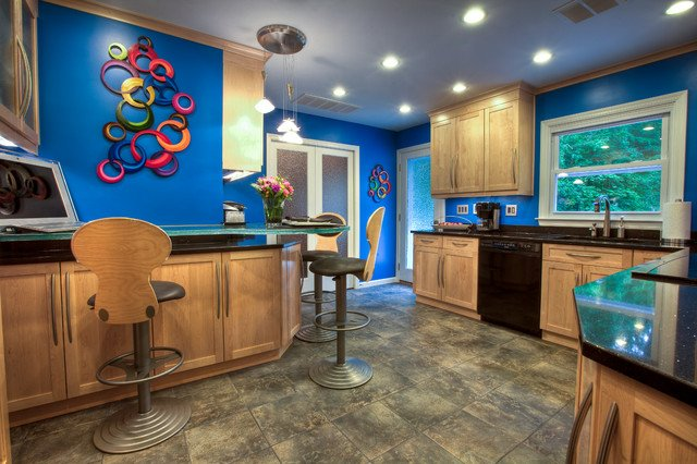 Vibrant blue walls stand out in this contemporary kitchen