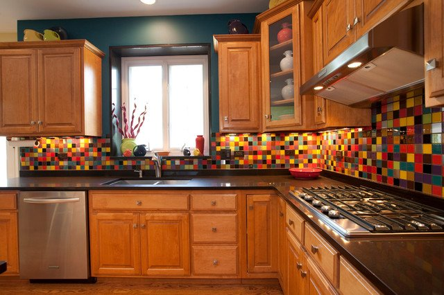 Colorful tile backsplash enlivens this kitchen