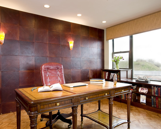 Leather wall panels enhance a masculine office