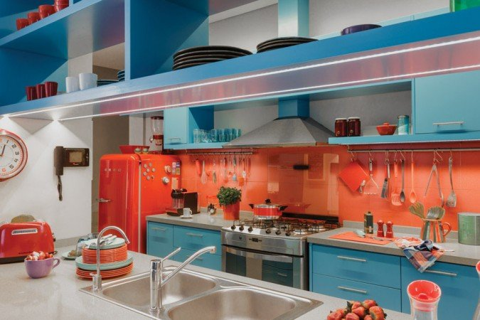 Orange and aqua make an exciting color combo in this modern kitchen