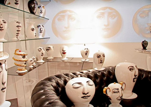 Various decorative accessories featuring  Fornasetti's creation