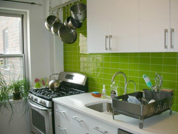 Lime green glass tiles add vibrant color to this kitchen