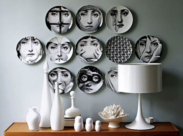 Featured in a vignette, Fornasetti plates create a unique statement