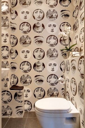 Fornasetti wallpaper is a popular powder room accent