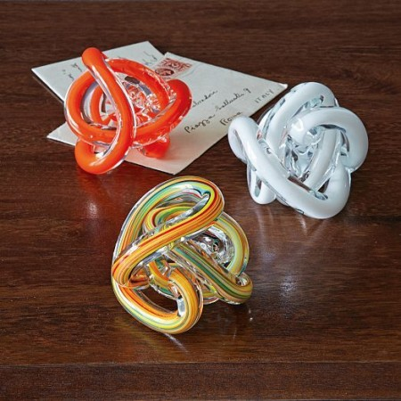 A collection of glass knot paperweights give a boost to table decor
