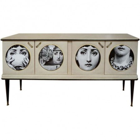 A sideboard with the Fornasettie motif