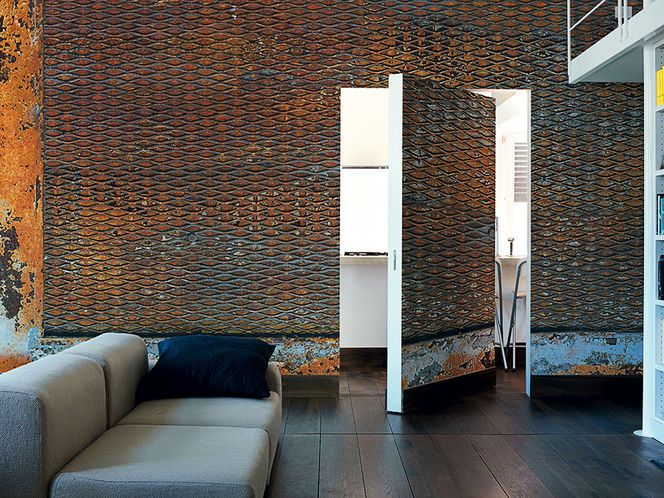 Rusted trellis wall treatment is a stand-out feature for this modern home