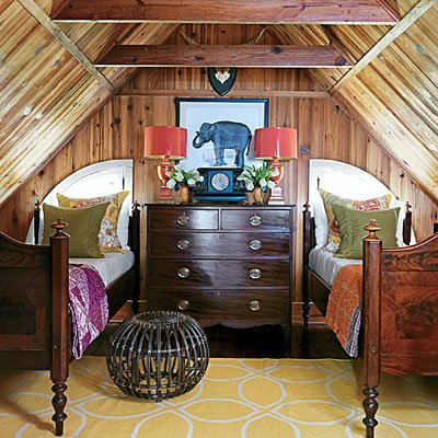 A dresser shared by both beds works in this small space
