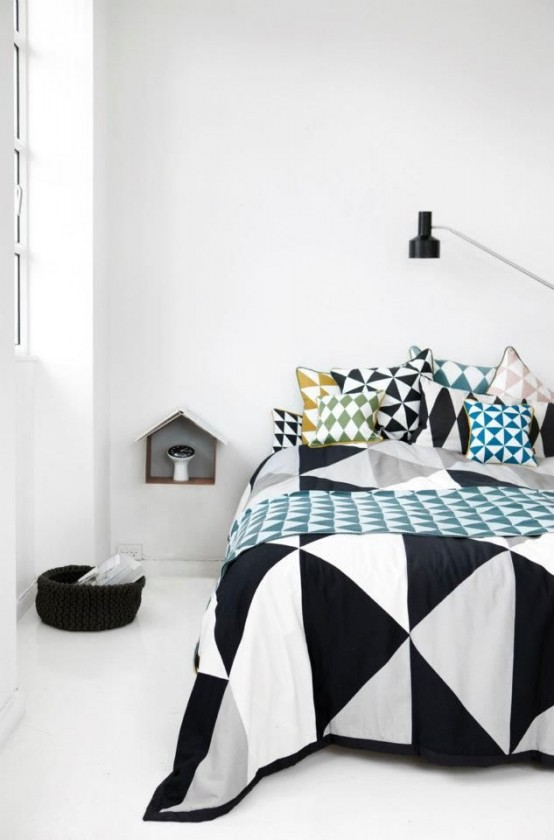 Geometrics liven up the minimalist bedroom(www.digsdigs.com)