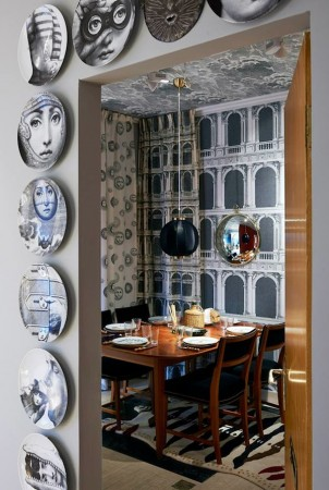 Fornasetti's plates accent this wall