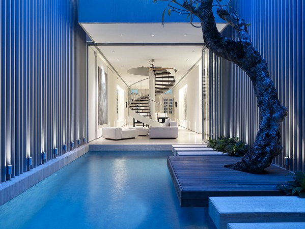 Curving staircase and indoor pool make a statement in minimalist interior