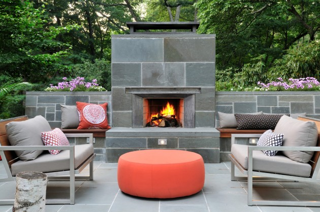 Gather around the fire with comfortable seating in this modern outdoor space