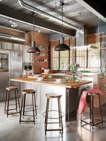 An industrial kitchen with exposed brick walls