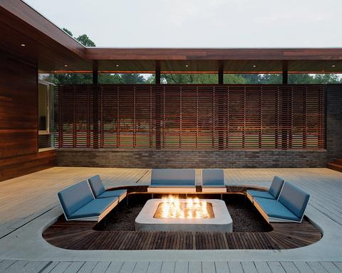 Fire pit enchants this modern outdoor space