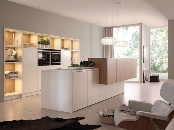 A stylish minimalist kitchen fits seamlessly into this open floor plan