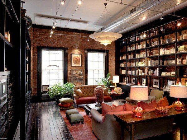 A warm and inviting room with brick accent wall