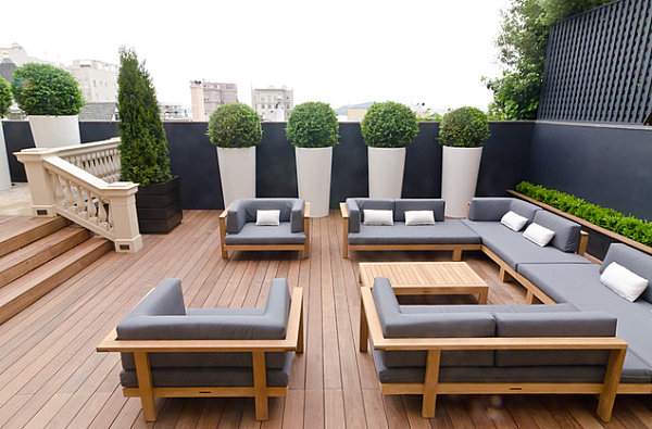 City views are the highlight of this rooftop living area