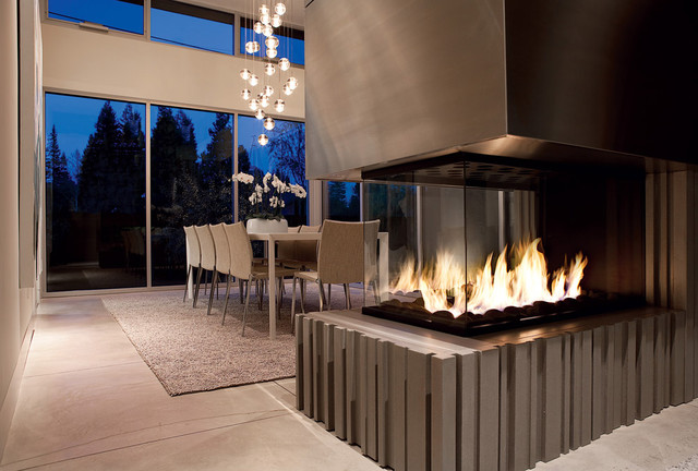 A Central Fireplace Takes Center Stage Between Living And Dining Areas