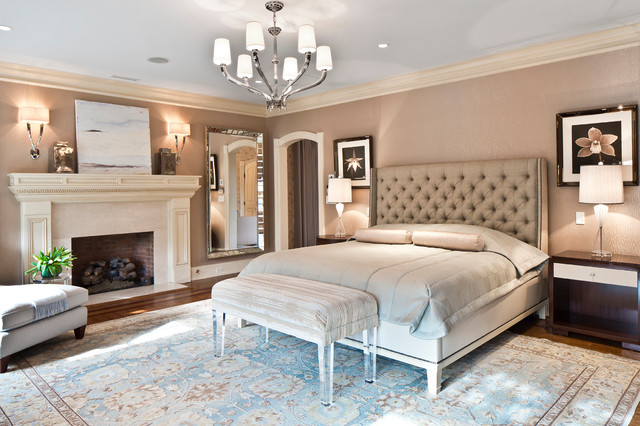 A tufted headboard and cozy linens make this bedroom comforting and luxurious