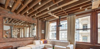 Exposed brick enhances this loft space